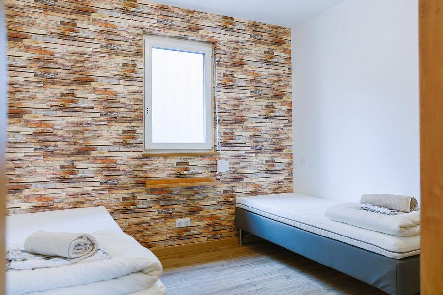 La Maison Devant La Prairie  Chambre avec lits individuels
